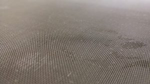 Close up of mesh on the vibrating screen.