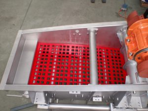 Vibrating screen with cross tension polyurethane mesh.