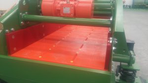 Vibrating screen with polyurethane screen panels.