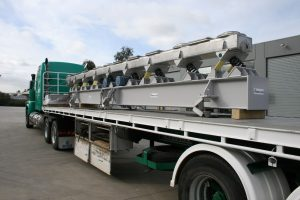 Vibrating conveyor on truck ready for dispatch.