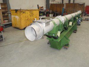 Discharge end of vibrating tubular conveyor.