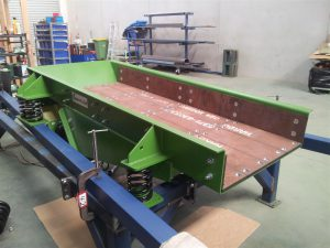 Vibrating feeder with thick Bisalloy Liners.