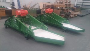 Vibrating feeders with ceramic liners.