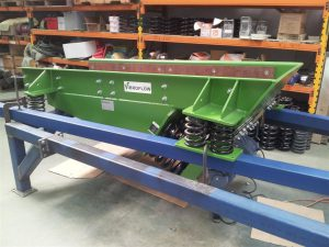 Vibrating feeder with steel coil springs as isolators.
