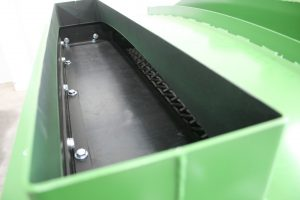 Impact deck on vibrating screen with rubber liner.