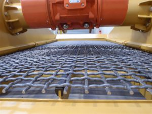 Vibrating screen with woven wire mesh.